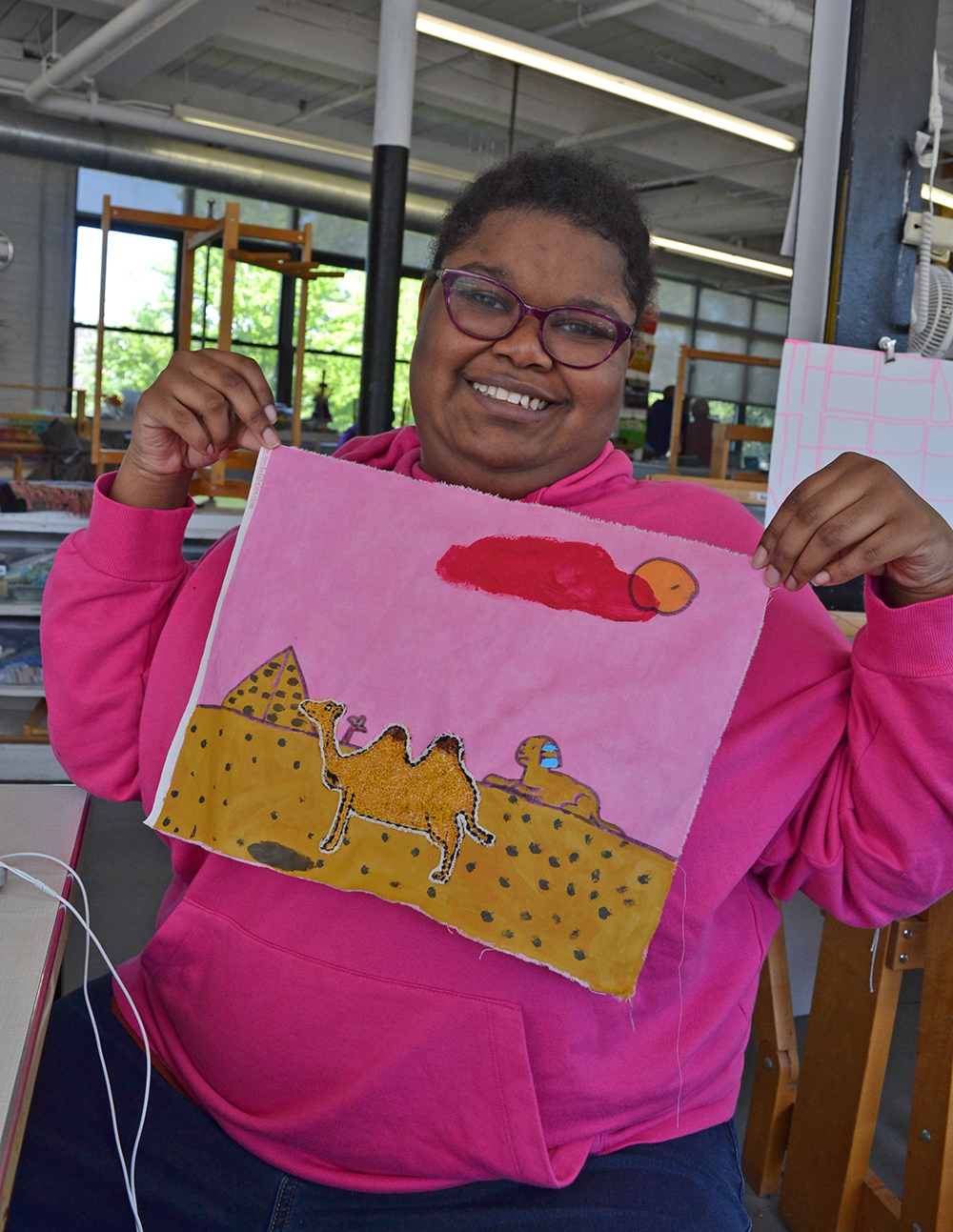 Jamilah Monroe showing off her artwork