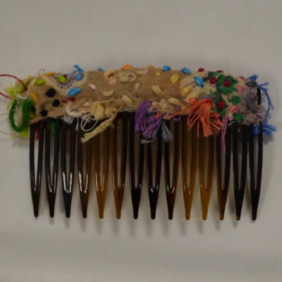 Brown hair comb by Amy Caliri