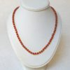 Orange necklace by Anonymous