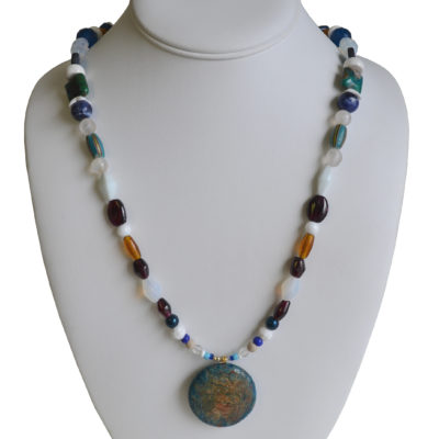 Blue, garnet and teal necklace by Barbara Brown