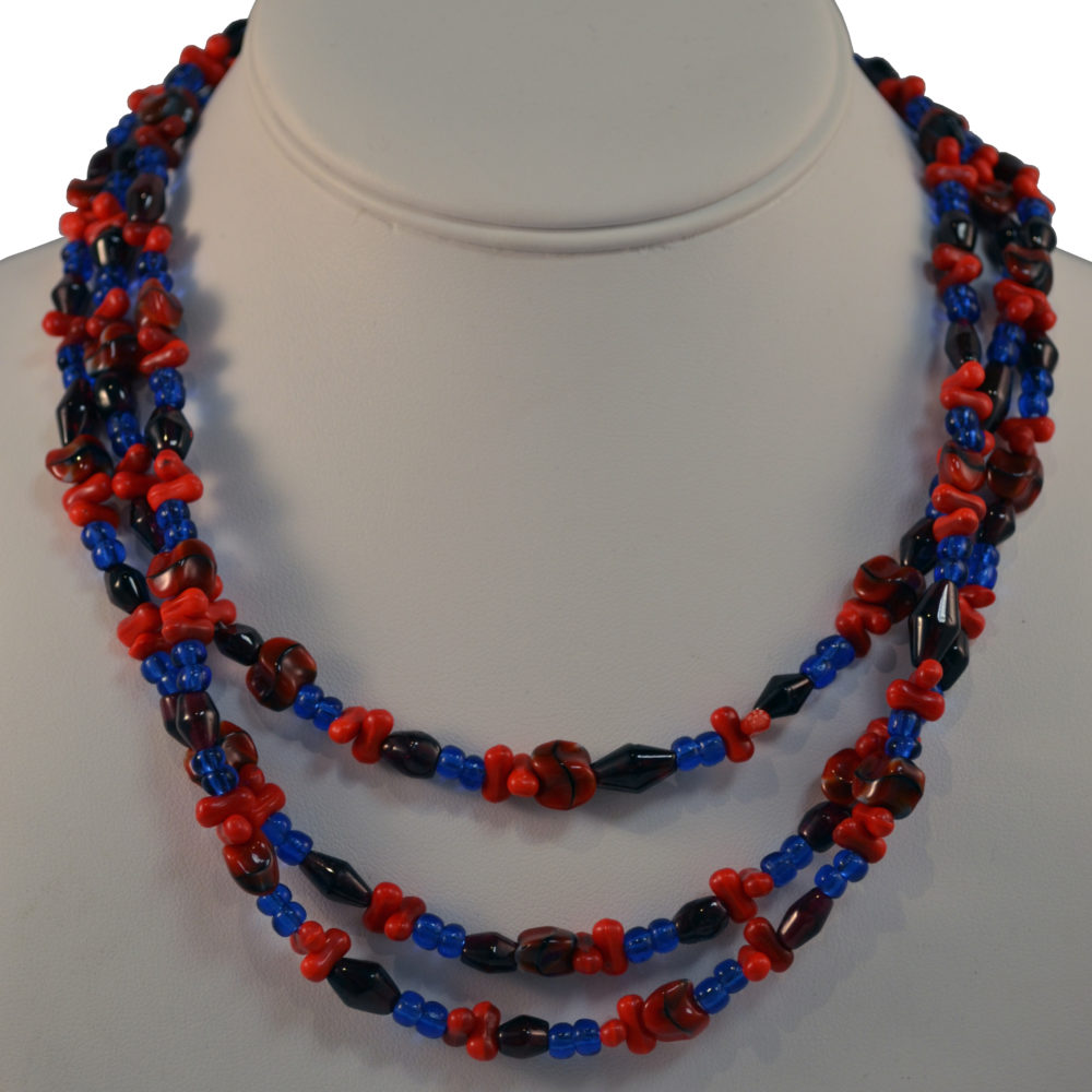 Red and blue multi-strand necklace by Brenda Sepulveda