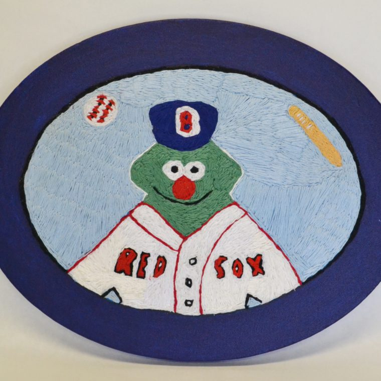 Green monster embroidery by Brenda Sepulveda.