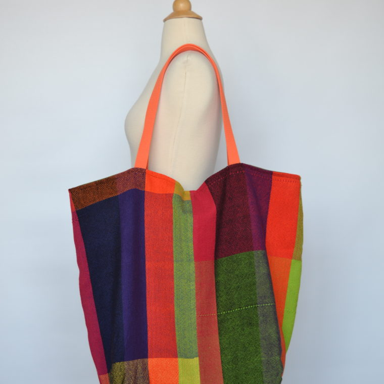 Handmade woven tote bag with orange straps by Jordana Simpson