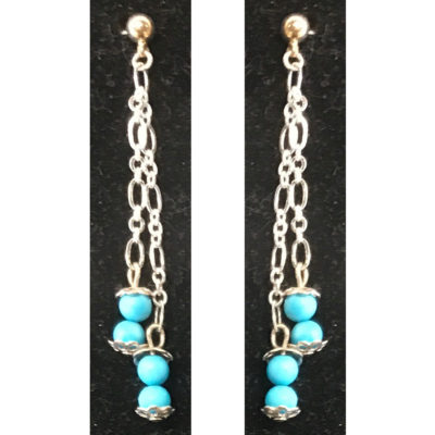Earrings with turquoise colored beads by Judy Phillips