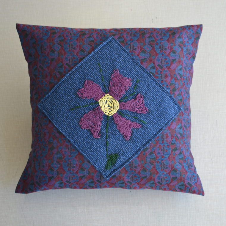 Purple flower pillow by Juvenia Nicodemos