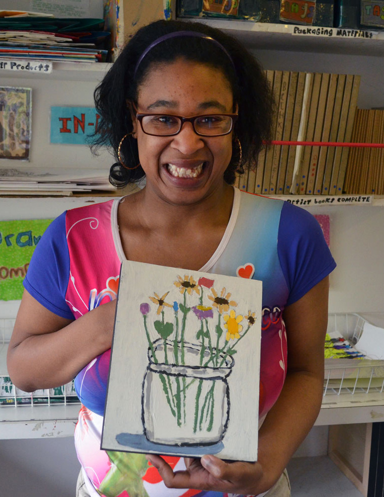Kayla Johnson showing off her artwork