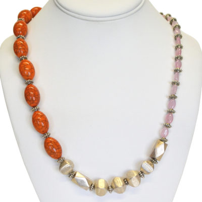 Orange asymmetrical necklace by Kayla Johnson