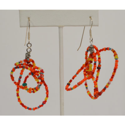 Orange earrings by Kenneth Reynolds
