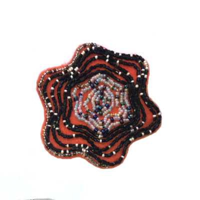 Orange and black coaster by Kenneth Reynolds