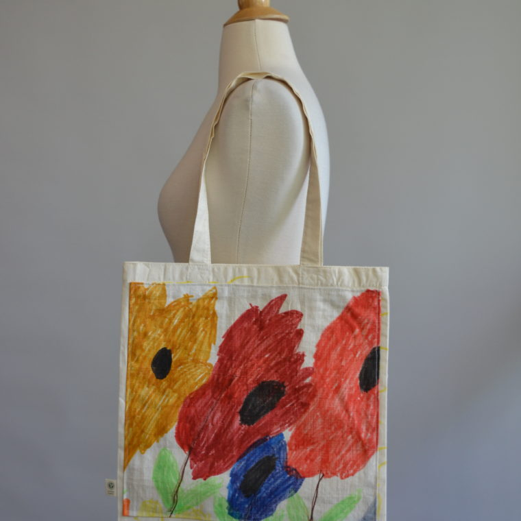 Flowers and Suns tote by Maria Fulchino