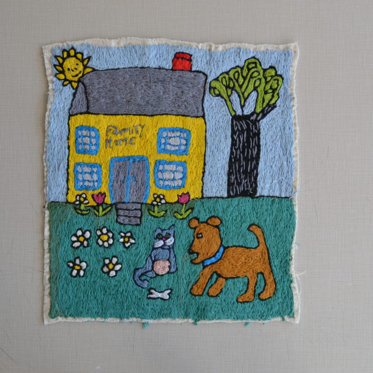 Family Home embroidery by Mary DeCesar