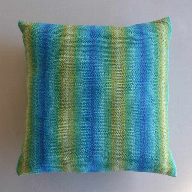 Blue and green woven pillow by Ona Stewart