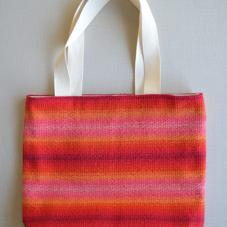 Woven red and orange tote bags by Ona Stewart