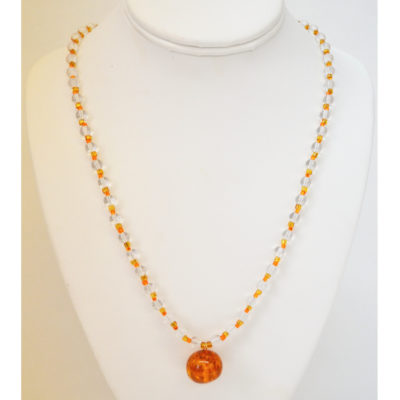 Orange orb necklace by Sofia Bocanegra